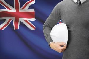 Architect with flag on background - New Zealand